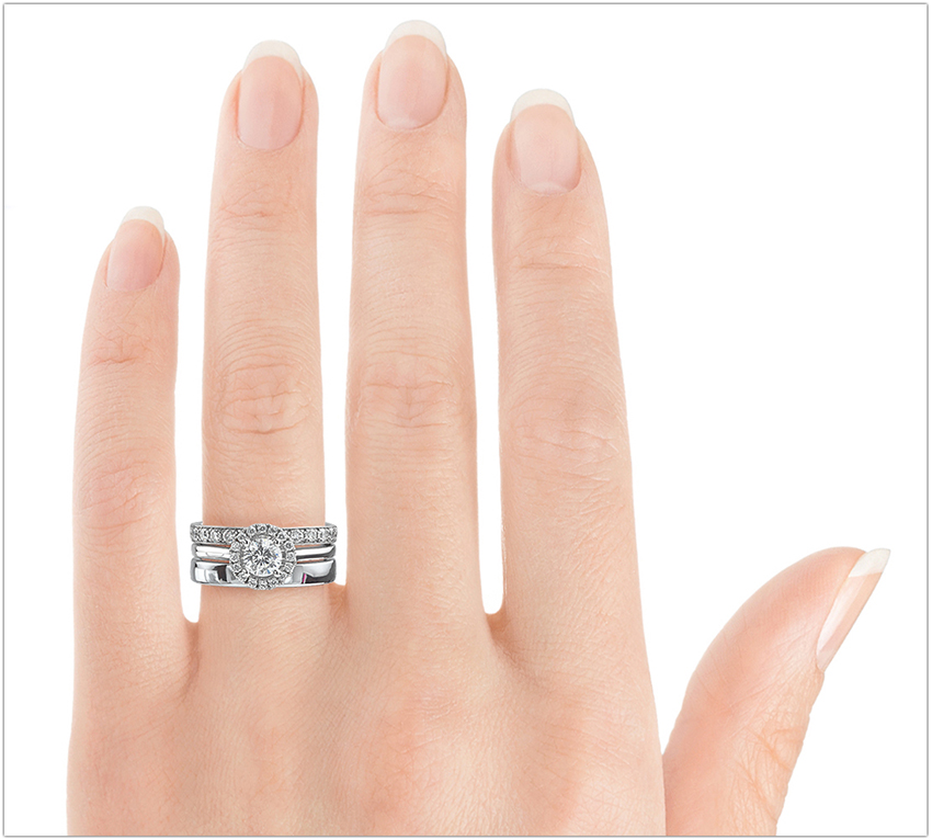 Showing an engagement ring, wedding ring and eternity ring in order on the hand